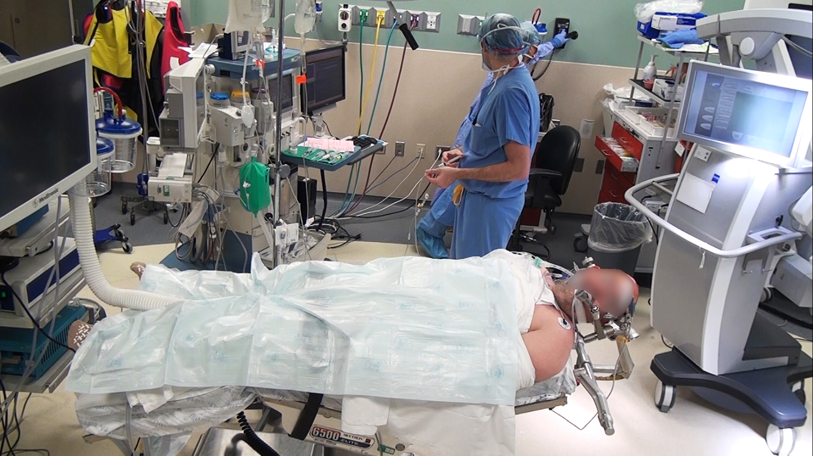 Figure 2: A modern operating room setup must accommodate the location and arrangement of its components in relation to the patient. These components include the operating and anesthesia teams, the ancillary staff, and a variety of equipment.