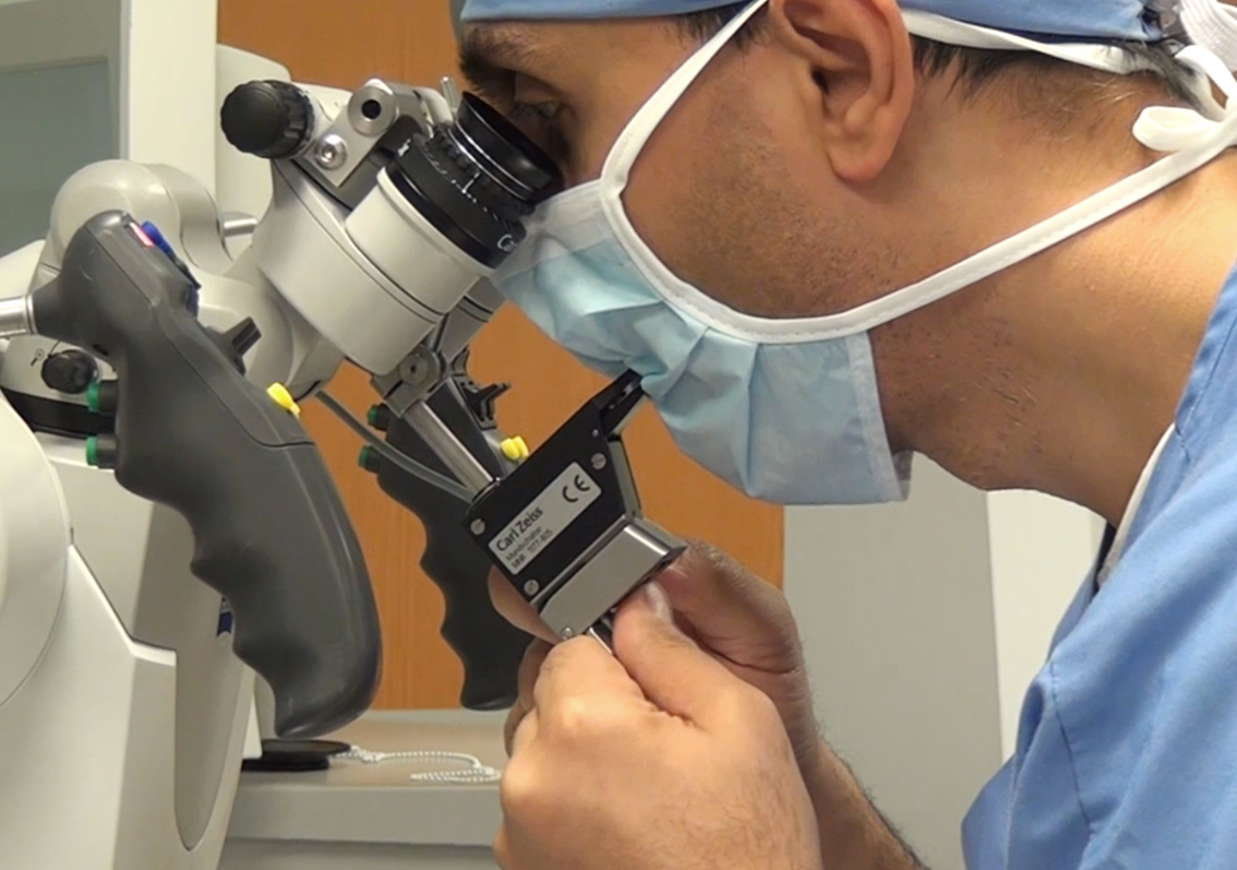 Figure 3: The mouthswitch is adjusted before the microscope is draped at the beginning of the operation.
